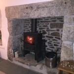 Recently restored granite inglenook fireplace